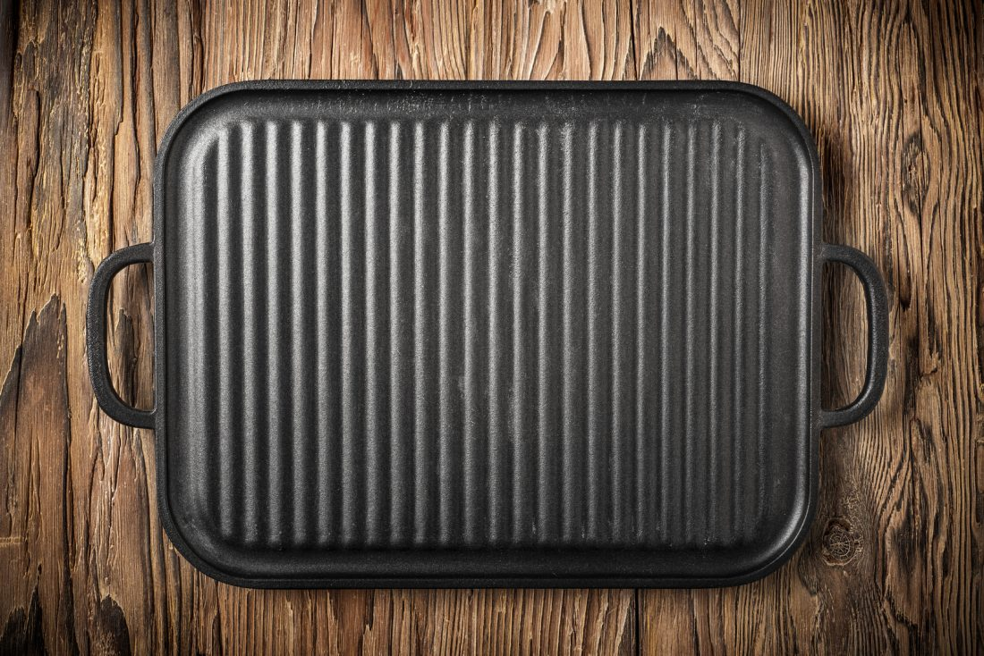 iron grill on aged wooden table,food background