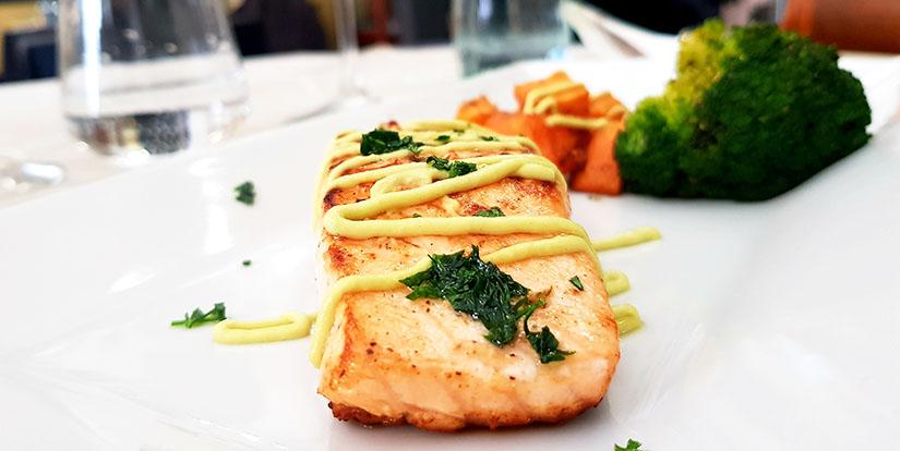 Salmon with sweet potato broccoli and avocado dressing